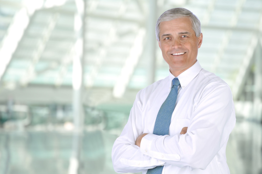 Businessman in Lobby of Modern Building
